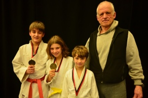 CALEB MILLARD and brothers Amani and Moses Bovenzie won gold medals at the Seikidokan Youth Provincial championship in Langley. Instructor Henry Boas, far right, was very impressed with their performances